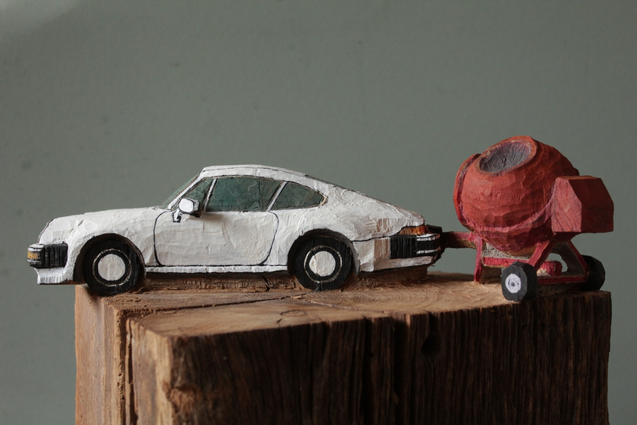 Porsche mit Betonmischer