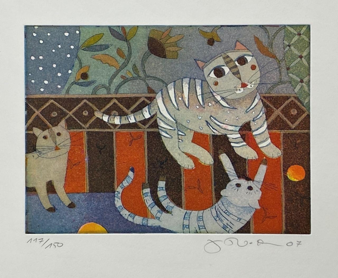 Drei spielende Katzen