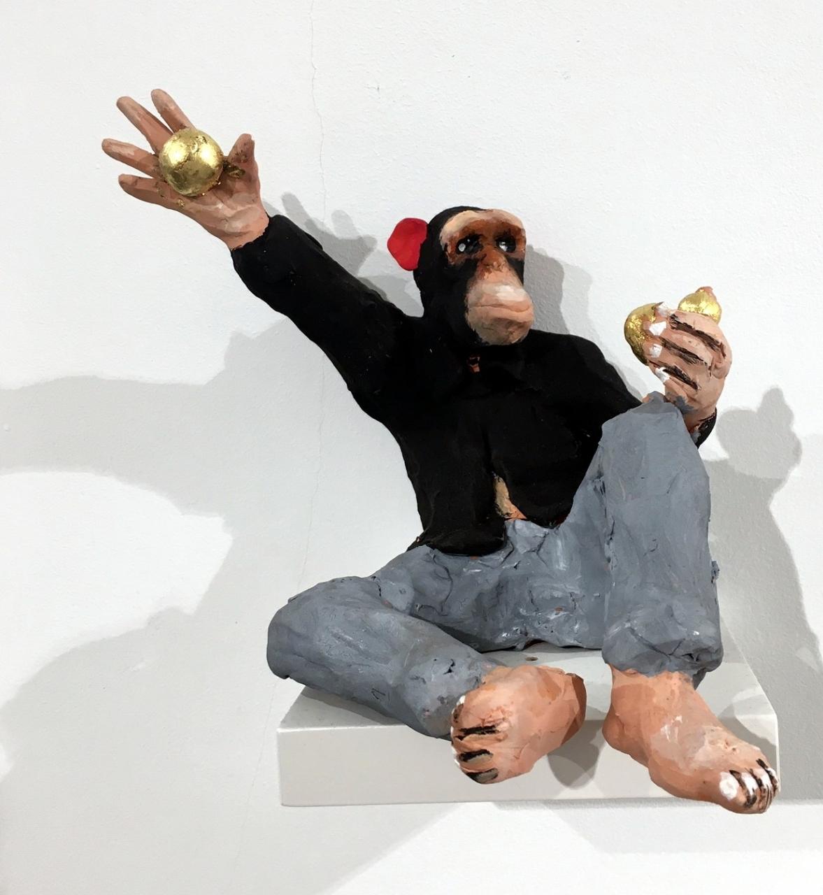 Ein Affe lässt menschliche Werte fallen