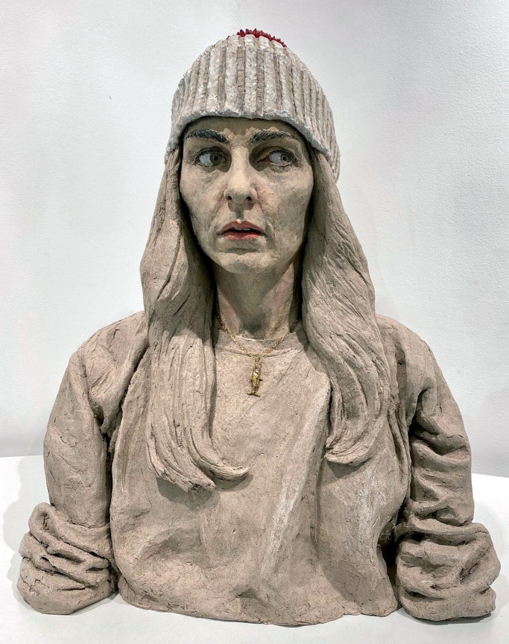 Frau mit Pudelmütze